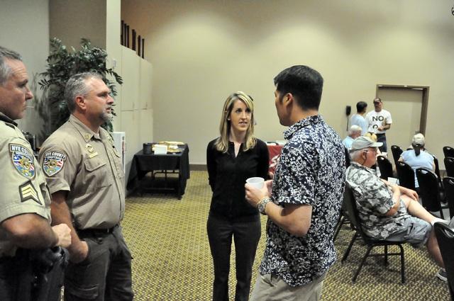 Horace Langford Jr. / Pahrump Valley Times - Nevadans for Freedom Nevada grassroots field coordinator Keely Hopkins and Las Vegas campaign field representative Kevin Kam talk to Nye County's Sheri ...