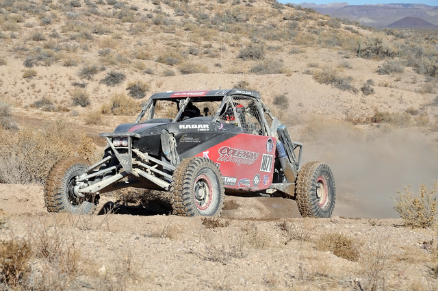 Horace Langford Jr. / Pahrump Valley Times  Jason Coleman drives  into pit four, where his family awaits to refuel his car. His father Joe Coleman said it takes his refueling team 14 seconds to re ...