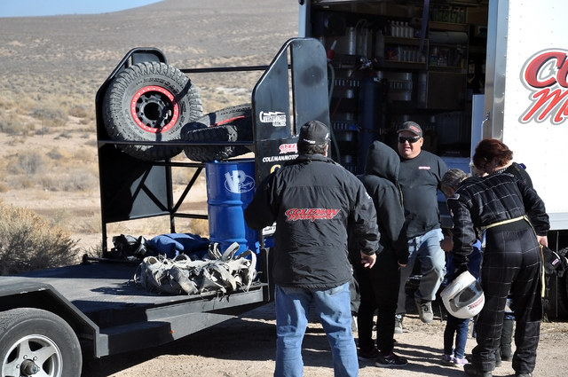 Horace Langford Jr. / Pahrump Valley Times - Coleman pit crew gets ready to refuel Jason Coleman's 1071 car. A shredded tire can be seen on the trailer bed at left, which was removed from the car  ...