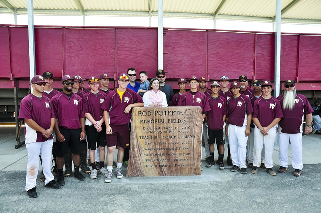 Horace Langford Jr. / Pahrump Valley Times  At the Rod Poteete Memorial dedication the 2016 Trojans gather around the Rod Poteete engraved stone with his image to show their appreciation for all t ...