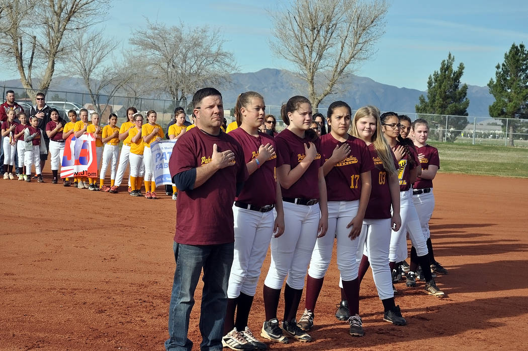 Standing tall and proud for the national anthem at the Pahrump Youth Softball Association opening day on Saturday, from left to right: 14U coach Shane Rily, Makayla Cadwell, Kate Daffer, Kaylynn S ...