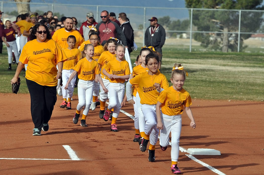 The Pahrump Youth Softball Association had its ceremonies on Saturday to open the season. Over 80 players took to the field to celebrate opening day. Horace Langford Jr. / Pahrump Valley Times