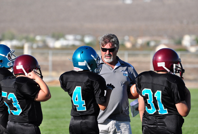 Horace Langford Jr / Pahrump Valley Times RCMS Fooball coach Dave Wright is in his second year as head coach. Above he gives his players instructions at the Beatty game last year.