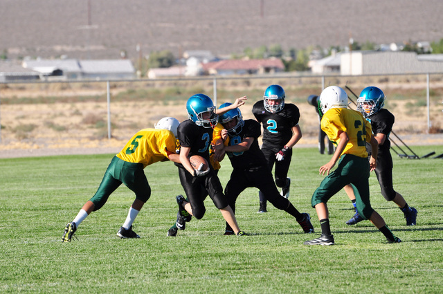 Horace Langford Jr./Pahrump Valley Times Rosemary Clarke football is very much alive despite low turnouts in Pop Warner. Head coach Dave Wright expects nearly 100 kids coming out for the sport.