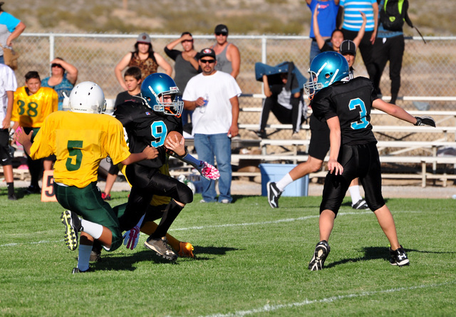 Horace Langford Jr./Pahrump Valley Times  Shark's football plays rival Beatty Middle School (yellow and green) last year.