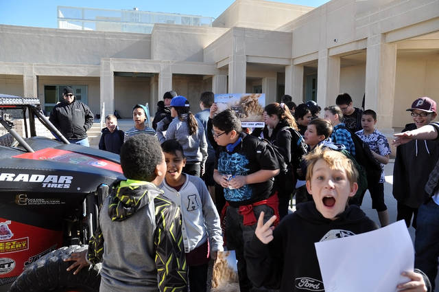 Horace Langford Jr. / Pahrump Valley Times  Excited kids at Rosemary Clarke Middle School gather around Jason Coleman's  Best in the Desert 1,000 Class car. Over 900 students got to see two cars a ...
