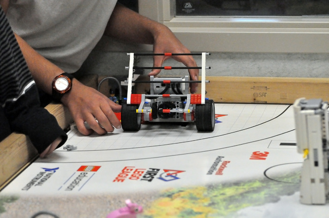Horace Langford Jr. / Pahrump Valley Times   A student prepares a Lego robot to complete a task on the robot board. The robots are provided by Lego and the students need to program them and improv ...