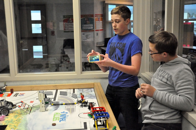Horace Langford Jr. / Pahrump Valley Times  Seventh grade RCMS student, Zach King, explains how his team won the robot competition on Dec. 3 at West Career and Technical Academy in Las Vegas. The  ...
