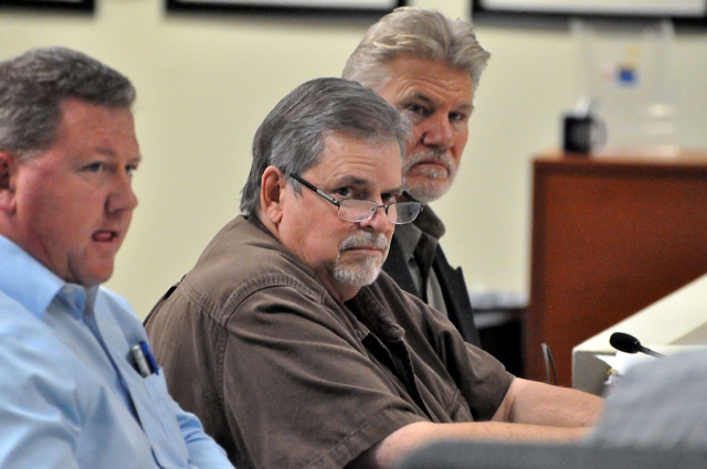 Horace Langford Jr. / Pahrump Valley Times - David Richards, of Civilwise Services, Inc., middle, and Mason Harvey, member of Pahrump Lands, LLC, right, requested an approval for a tentative comme ...