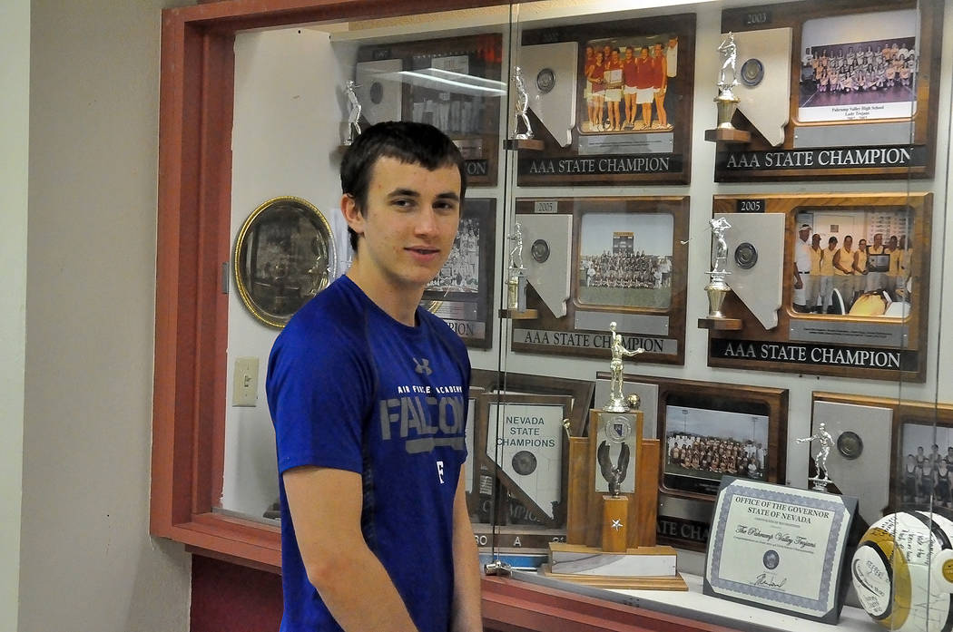 Joey Sladek admires the trophies in the trophy case at Pahrump Valley High School. The senior kicker will be entering the Air Force Academy in the fall. He was accepted on Dec. 3.  Horace Langford ...