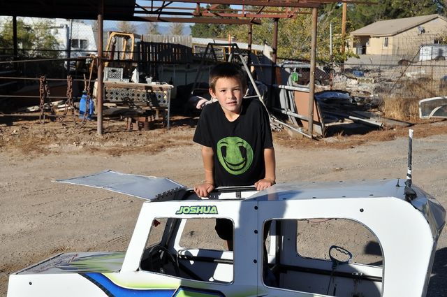 Horace Langford Jr. / Pahrump Valley Times  Joshua Slusher proudly displays his car at home. The car has the roll bar and cage like the bigger cars and even has the safety harness.
