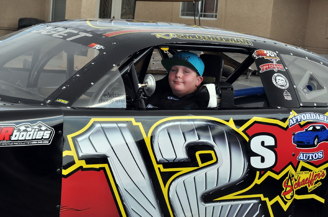 RJ Smotherman sits in his Junior Late Model Series car in front of his home in Pahrump. Once a month, Smotherman gets to drive the 500-horsepower beast at Madera Speedway in California. Horace Lan ...