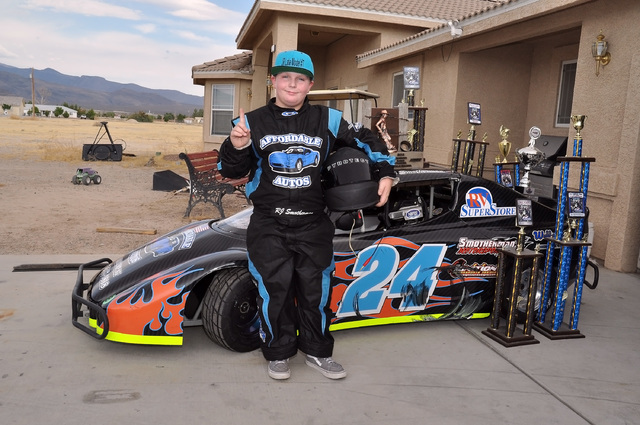RJ Smotherman, a local eleven-year-old racer, stands in front of his race trophies. He wants to be a NASCAR driver someday. Horace Langford Jr. / Pahrump Valley Times