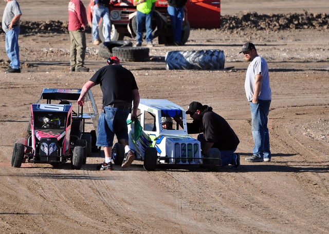 Horace Langford Jr. / Pahrump Valley Times  Joshua Slusher gets lined up properly by flagman Dale Geissler and receives pre-race instructions from his uncle, Eric Slusher, while his dad, Steve Slu ...