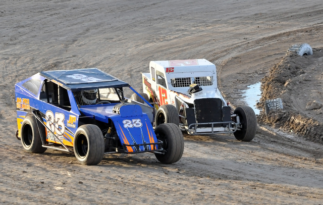 12-year-old Jake Pike in his no. 23 car, takes on a veteran Dwarf car racer at the Pahrump Valley Speedway on Saturday. Horace Langford Jr. / Pahrump Valley Times