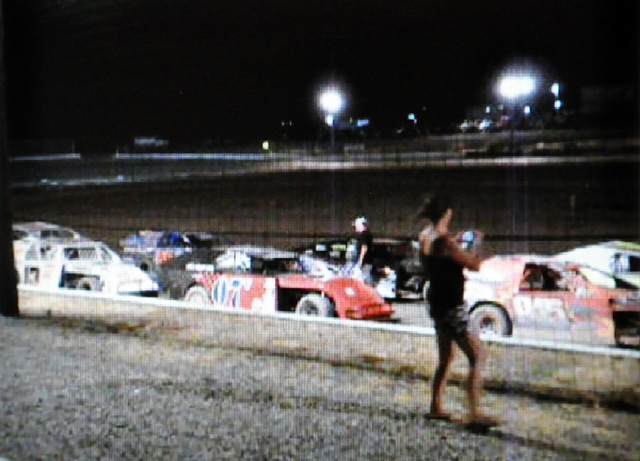 Vern Hee / Pahrump Valley Speedway Speedway flagman, Dale Geissler (white hat) can be seen lining up the 21 Modified cars before the race, which was one of the largest fields in the race's history ...