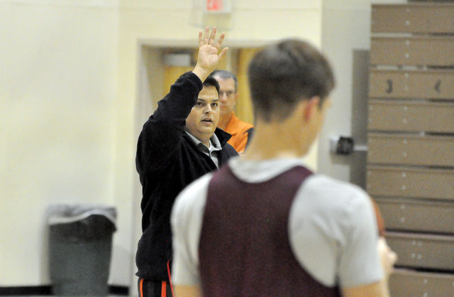 Assistant coach James Taylor demonstrates a drill to one of the varsity team members. This is Taylor's ninth year coaching basketball.  Horace Langford Jr. / Pahrump Valley Times