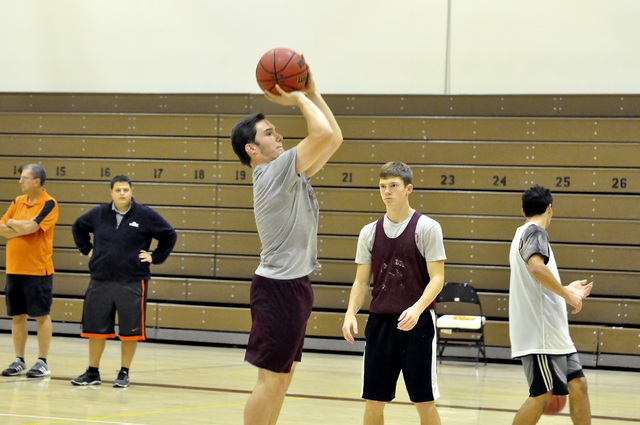 Horace Langford Jr. / Pahrump Valley Times - PVHS Boys basketball coach James Taylor (in black) watches the team practice.