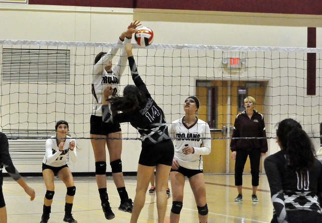 Horace Langford Jr. / Pahrump Valley Times   Koral Hearn stuffs a Miner attack as Bethany Clavert (#11) and Alexis Trieb (#1) looks on. The Trojans won in 3 sets, which was played in 45 minutes.