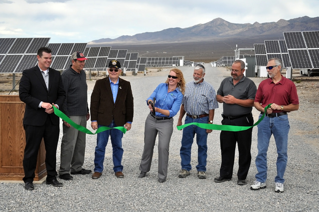 Horace Langford Jr. / Pahrump Valley Times -  Officials cut a ribbon at the opening ceremony of Valley Electric, Inc.'s 15-megawatt community solar project. Output will be available for Valley Ele ...