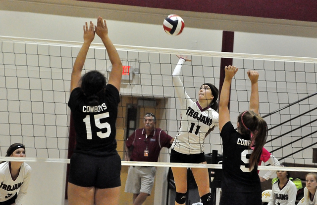 Bethany Calvert goes high for a ball during the playoff game against Chaparral on Monday. The Trojans won in three sets. Horace Langford Jr. / Pahrump Valley Times