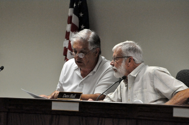 Horace Langford Jr / Pahrump Valley Times - Nye County Water District Governing Board member Ken Searles (left) and Chairman Dave Hall (right) attend the July 25 meeting. Officials directed Nye Co ...