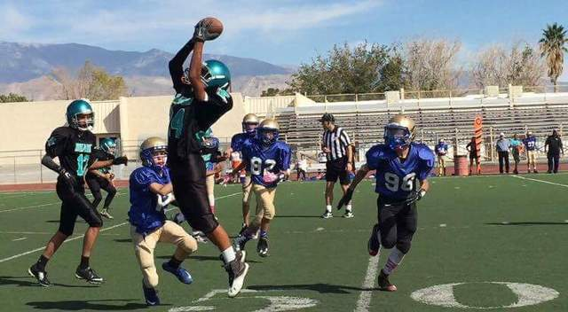 Special to the Pahrump Valley Times Jaden Mojopian catching pass from Antonio Margiotta (#42), while Cameron Gabrylczyk looks on. Rosemary Clarke is unbeaten in four games this season.