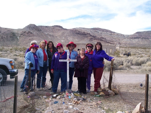 Garden Mistresses Chapter of the Red Hat Society out of Pahrump after painting the Mona Bell grave marker during the restoration in 2010 or 2011. The group decided to clean, repair and decorate he ...