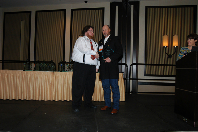 Joe Crim NASB board president and school board member for Pershing County presents Pahrump Valley High School teacher, Robin Williams with his School District Employee Making a Difference Award at ...