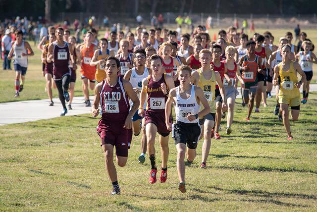 Special to the Pahrump Valley Times The start of the race shows Trojans runner Bryce Odegard clearly in third place behind William Fallini-Haas of Spring Creek and one other runner. Odegard said h ...