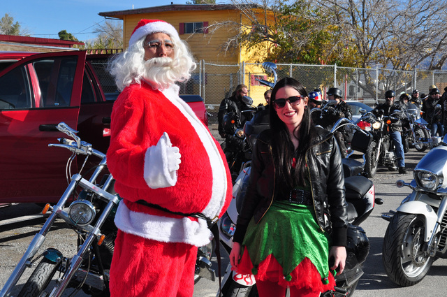 Santa and a helper prepare for the Tribe Motorcycle Toy Run in 2014. The group is seeking toy donations to deliver to area children. Special to the Pahrump Valley Times