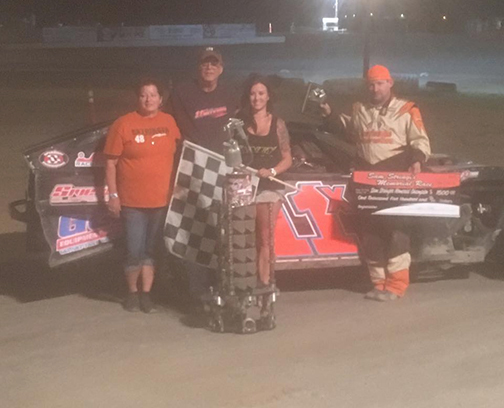 Special to the Pahrump Valley Speedway Race organizer, Sheree Stringer at left, poses with the winner of the Sam Stringer Memorial, Levi Kiefer, (right). This was Kiefer's third Sam Stringer win.