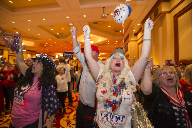 Las Vegas resident Stephanie Smith, second from right, and others as Donald Trump is announced President during an election night event hosted by the Nevada Republican Party at South Point hotel-c ...