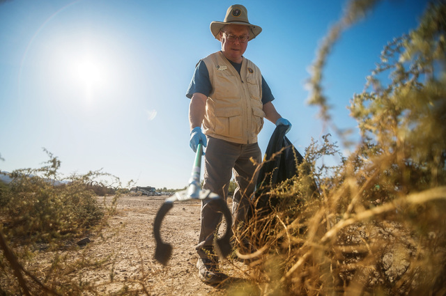 Volunteer Ed Madej reaches for litter during a clean-up event in Death Valley National Park. Courtesy of National Park Service