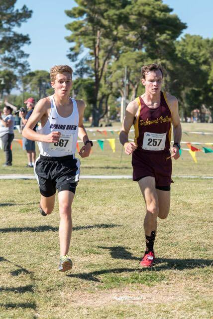 Special to the Pahrump Valley Times Trojans runner Bryce Odegard ran neck and neck with William Fallini-Haas of Spring Creek until the last 800 meters of the race and then Odegard kicked it in and ...