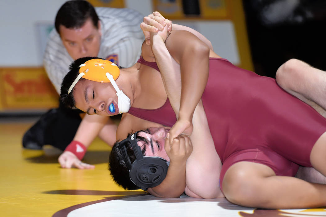 Peter Davis/Special to the Pahrump Valley Times Angel Pinzon, of the Pahrump Valley team, pinned his Desert Pines opponent in 59 seconds earlier this month. The Trojans captured the Sunset League  ...