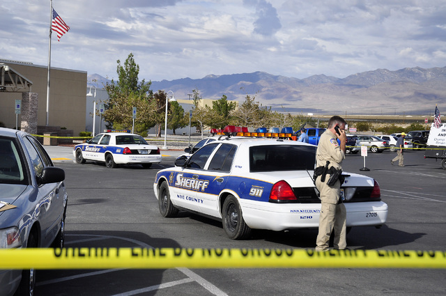 Horace Langford Jr. /Special to the Pahrump Valley Times  A Nye County sheriff's deputy talks on the phone in front of the Ian Deutch Justice Complex as shown in a file photo. Nye County plans to  ...