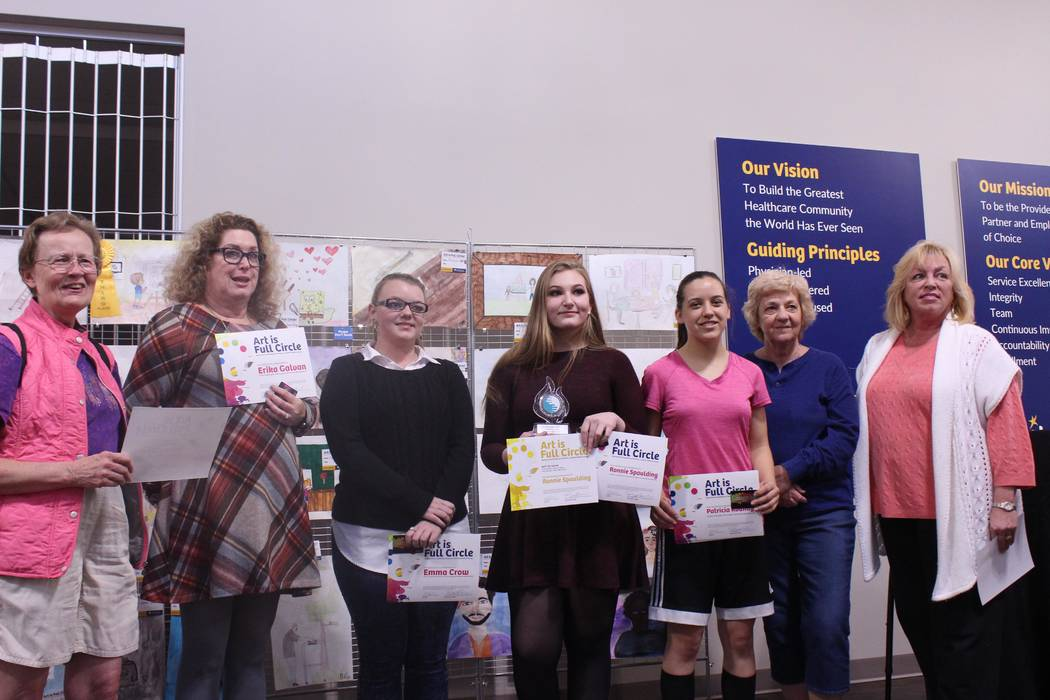 Jeffrey Meehan/Pahrump Valley Times Winners of the Art is Full Circle contest stand for a photo at the HealthCare Partners' building at 1397 S. Loop Road. HealthCare Partners worked with Pahrump V ...