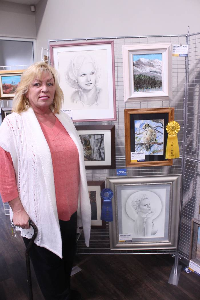 Jeffrey Meehan/Pahrump Valley Times Julia Elwell won the no. 1 spot for her portrait she entered into the Art is Full Circle contest at the HealthCare Partners' building at 1397 S. Loop Road. Heal ...
