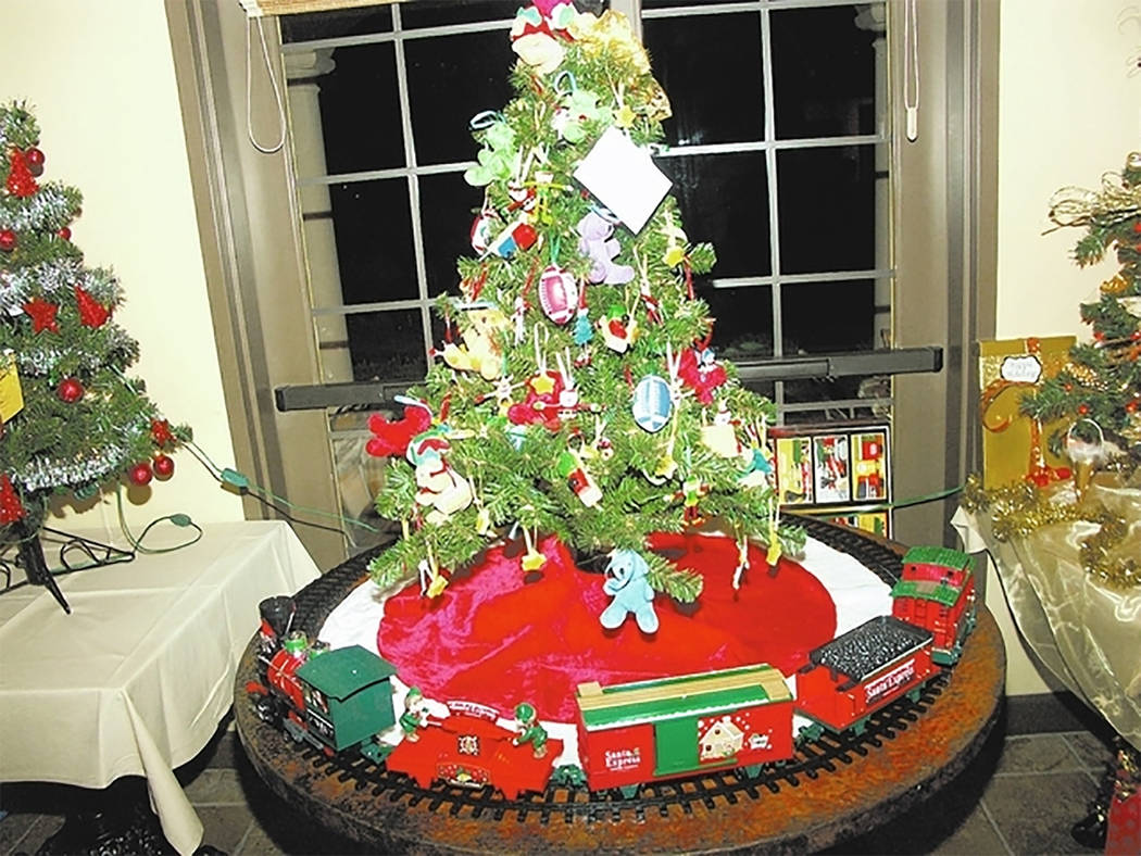 "Selwyn Harris/Pahrump Valley Times  The 13th annual ""Festival of Trees"" returns to Mountain Falls Golf Club tonight at 6 p.m. The celebration serves as a fundraiser for Nathan Adelson Hospice, ..."