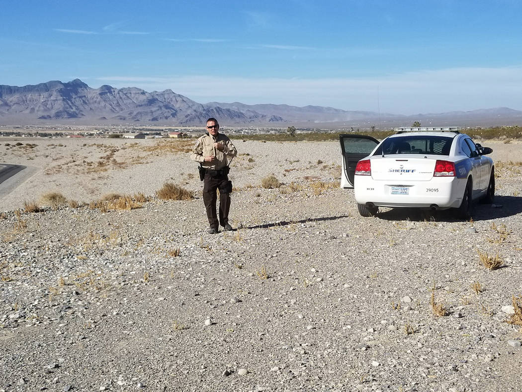 Special to the Pahrump Valley Times A Nye County Sheriff's deputy stands watch at the Nevada Southern Detention Center Saturday early afternoon. Staff at the facility said the inmate who attempted ...