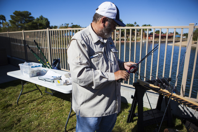Miranda Alam/Las Vegas Review-Journal  Rod Truman, a volunteer fishing instructor with the Nevada Department of Wildlife, packs up fishing rods during a senior fishing derby  in 2016.