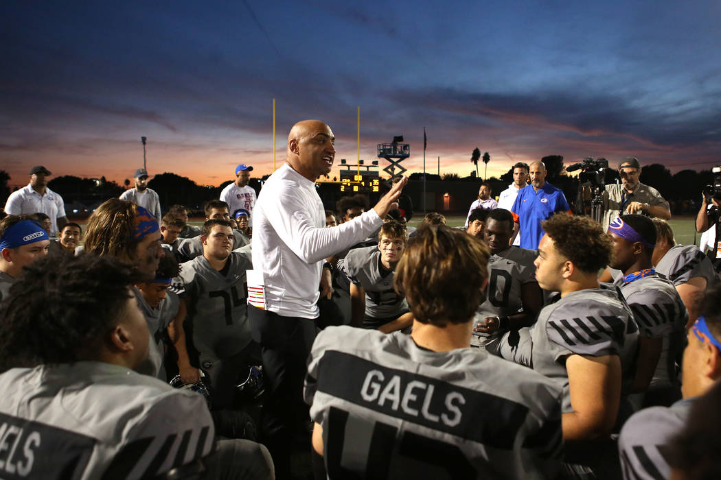 Bridget Bennett/Las Vegas Review-Journal  Bishop Gorman head coach Kenny Sanchez talks to his team after their class 4A state semifinal football game against Liberty at Rancho High School in Las V ...