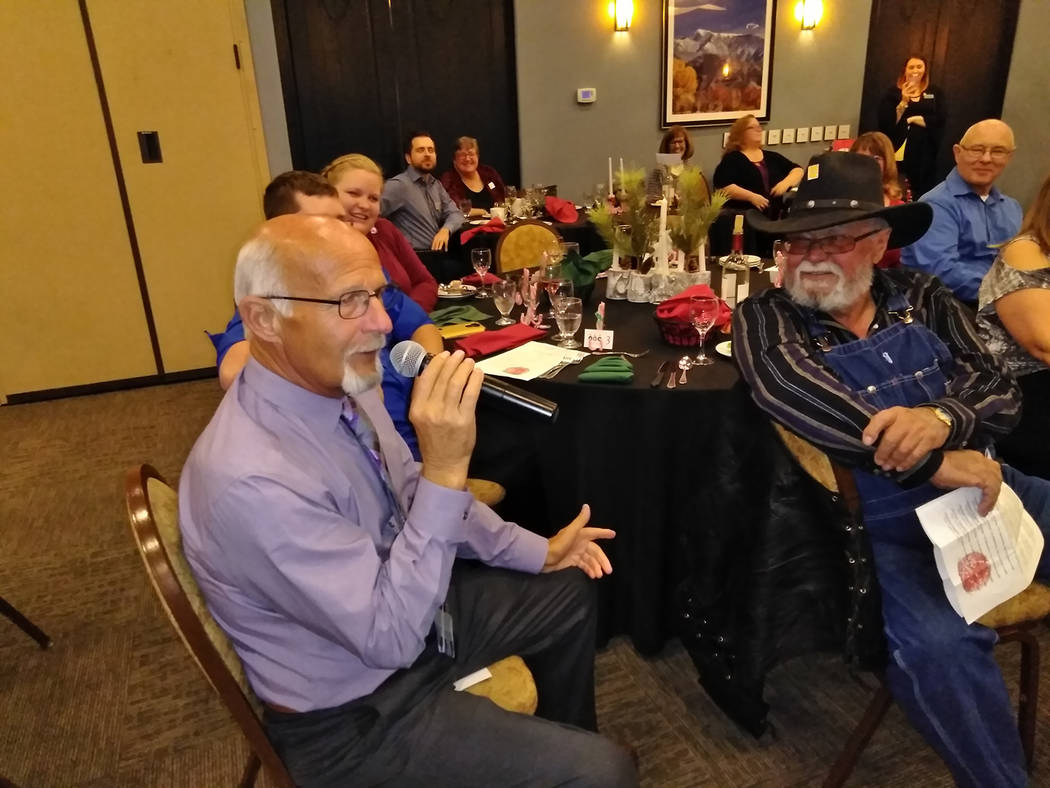 Selwyn Harris/Pahrump Valley Times  Auctioneer Ski Censke engages the crowd during Friday evening's Festival of Trees fundraiser for Pahrump's Nathan Adelson Hospice at Mountain Falls Grill Ro ...