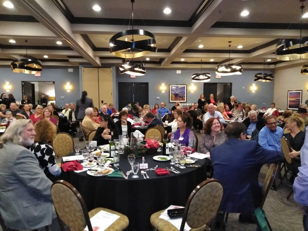 Selwyn Harris/Pahrump Valley Times Organizers for the13th annual Festival of Trees auction were forced to add an additional table and chairs to seat the more than 160 guests attending the Dec. 1 e ...