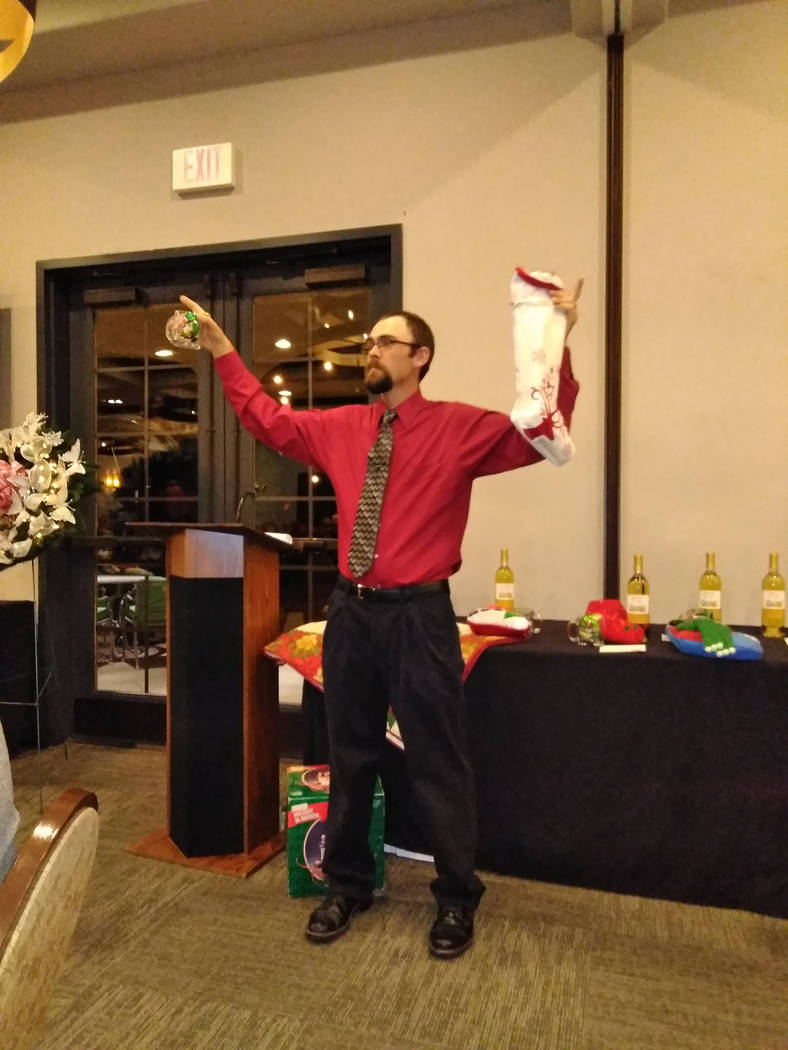 Selwyn Harris/Pahrump Valley Times  Auctioneer Ron Gipson holds aloft two items up for auction at the annual fundraising event. Gipson, along with co-auctioneer Ski Censki drew as many laughs duri ...