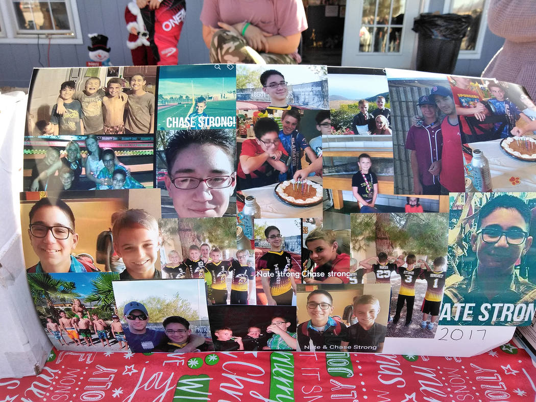 Selwyn Harris/Pahrump Valley Times  A photo collage depicting Nathaniel Bautista-Cleveland, and close friend Chase Otteson graced the bake sale table at Sunday's carwash fundraiser at 'The Oth ...