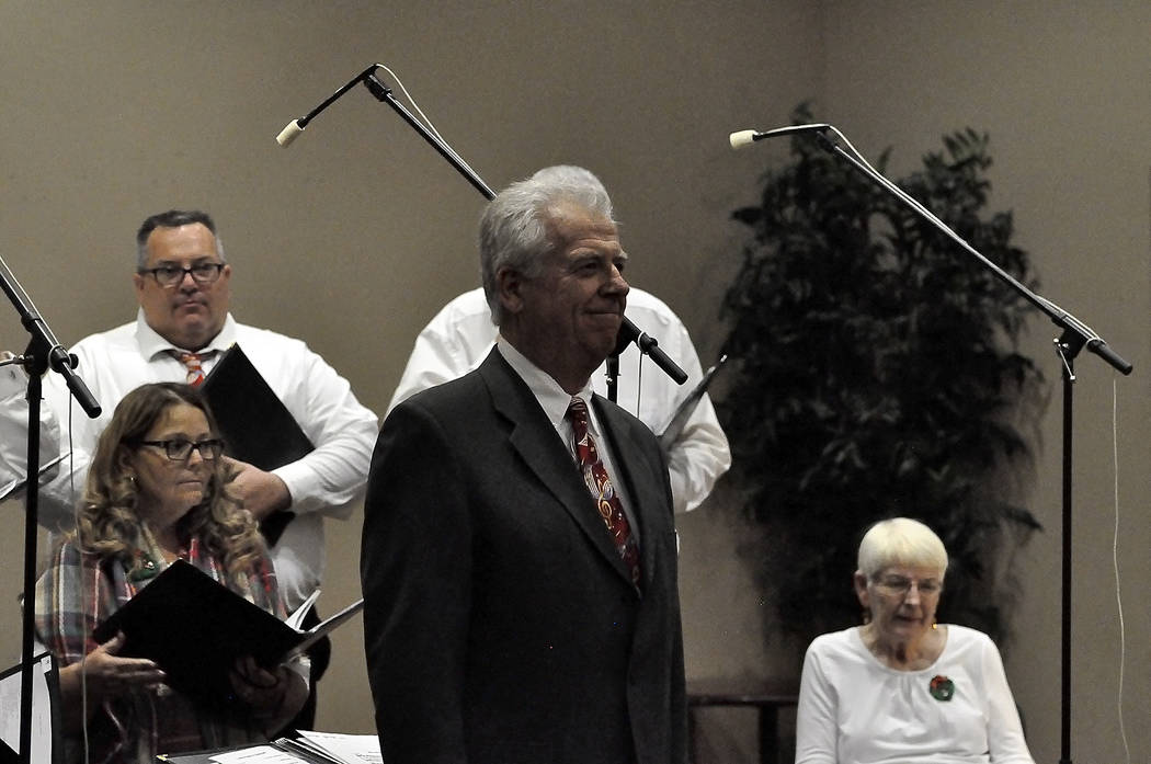 Horace Langford Jr./Pahrump Valley Times High Desert Chorale director Andrew Barnum performs his final concert on Dec. 6 after 14 years with the chorale. The Pahrump Nugget Event Center served as  ...