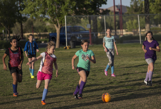 Jacob Kepler/Las Vegas Review-Journal The American Youth Soccer Organization (AYSO) region 1258 kids under 12 team practices at Summerlin Centre Community Park in Las Vegas on Monday, April 6, 201 ...