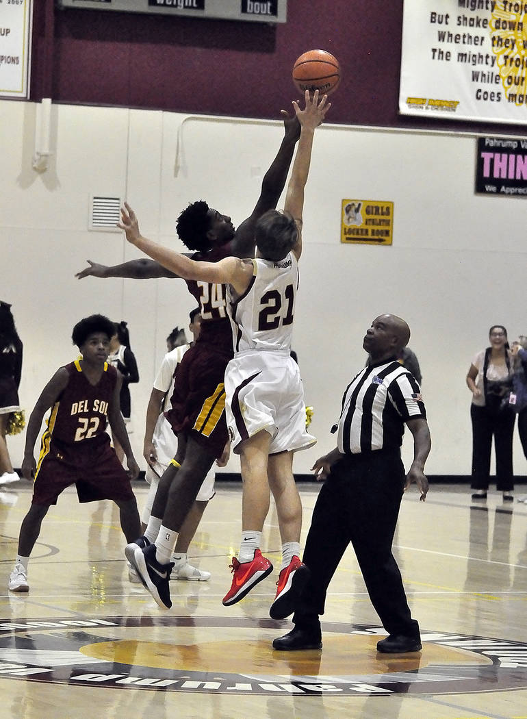 Horace Langford Jr./Pahrump Valley Times The Pahrump Valley High School boys basketball team lost its season opener to Del Sol 50-47 on Nov. 28. In this photo, Pahrump Valley's Brayden Severt (21) ...